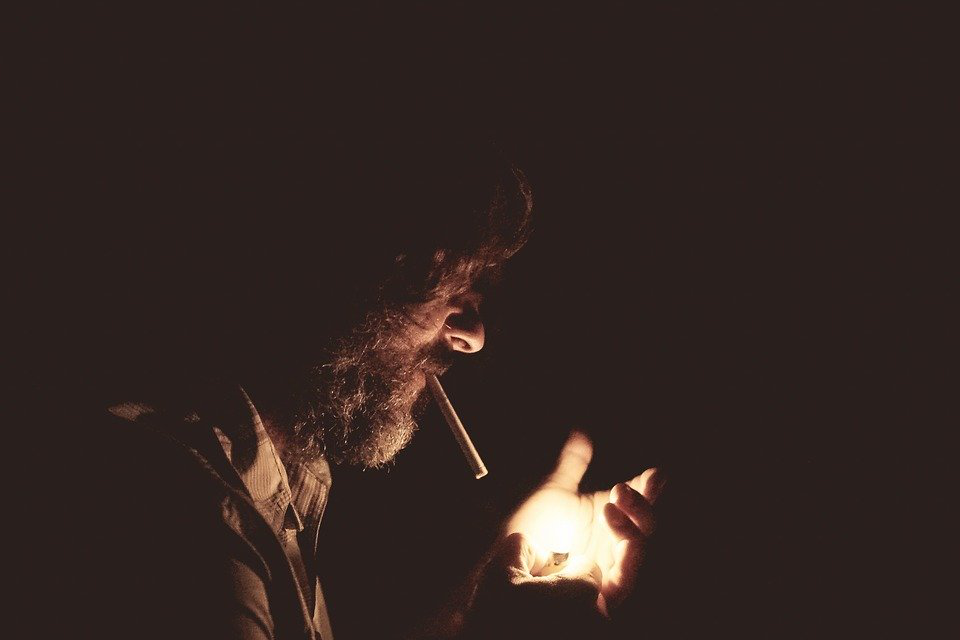 An Addict Lights Up A Cigarette