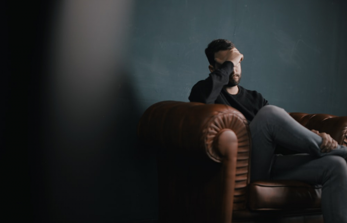 A person with PTSD sitting on a chair
