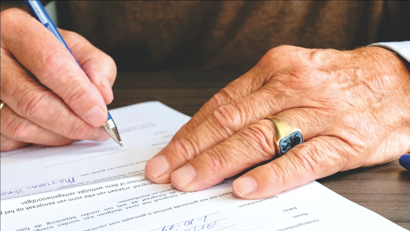 a person signing legal-application for social security benefits