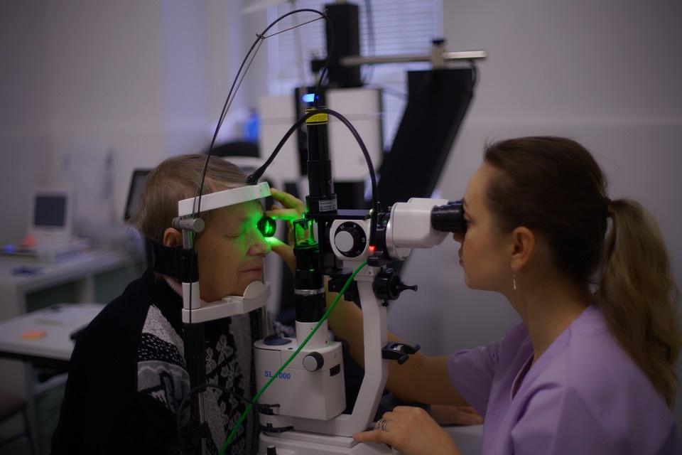 A person receiving an eye care consultation
