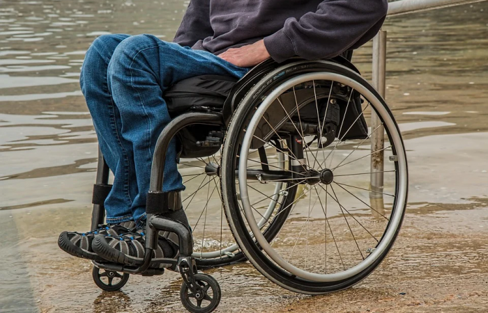 A disabled person in a wheelchair