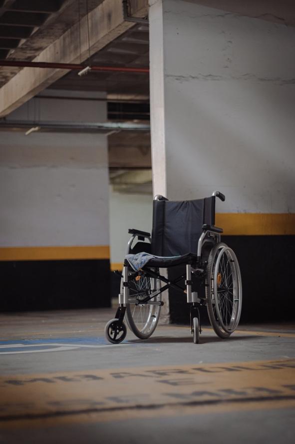 An empty wheel chair in a parking lot